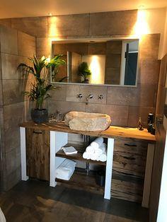 Handmade bathroom vanity made of reclaimed oak waggon boards, with a beautifull riverstone sink.
