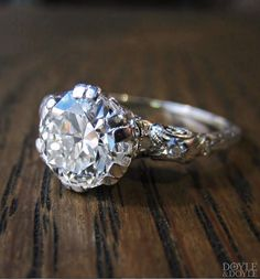 A diamond with a crown. Glamorous vintage 1950s diamond engagement ring with scrolling details, from Doyle & Doyle.