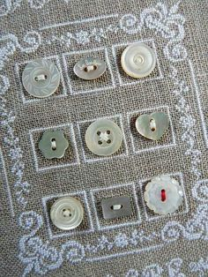 Embroider material and place buttons within pattern.