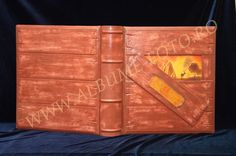A photo album made for a hunter. All the album is handmade. The leather is handpainted and the details also.