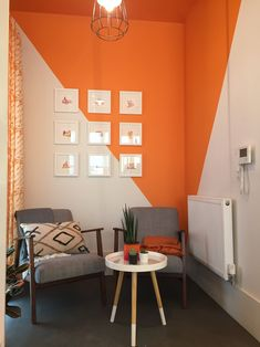 Relaxing Office Corner in Orange and White Bright orange seating area of an office. Painted ceiling and diagonal painted walls in orange and w Orange Wall Art, Orange Walls, Bedroom Orange, Orange Paint Colors, Orange Rooms, Bedroom Wall Designs, Bedroom Decor, Wall Decor, Half Painted Walls