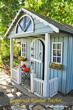 Sagebrush window baskets for a fall look on this cute playhouse.