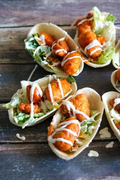 Mini Buffalo Chicken Salad Bowls are the perfect big game recipe!  All the flavor of buffalo wings but in an easy to eat tortilla boat!  #OEPBigGame @walmart