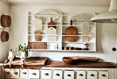 plate rack with cutting boards and cabinets with cubbie drawers-apothecary style