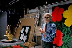 Andy Warhol in 47th street Factory in front of Flowers silk screen, NYC 1965.