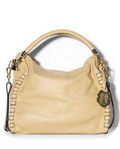 "Kat Hobo - Champagne$248  VINCE CAMUTO  KAT HOBO - CHAMPAGNE    This Vince Camuto hobo bag combines downtown-cool with uptown-chic for a stunning result. leather goldtone hardware 1 exterior back zipper pocket zipper closure 3 slip pockets, 1 zip pocket inside 12.25(L)"" x 11.75(H)"" x 3.5(W)""; 8"" shoulder drop Imported."