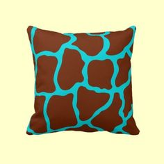 A bright turquoise and brown giraffe print decorates this retro style throw pillow. The design is from original art.