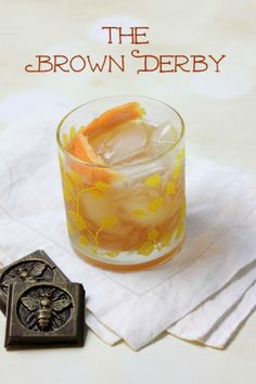 A classic cocktail of bourbon, grapefruit and honey syrup, the Brown Derby is named for the iconic Brown Derby restaurants in L. and epitomizes Hollywood's Golden Age. Bourbon Cocktails, Classic Cocktails, Cocktail Drinks, Cocktail Recipes, Drink Recipes, Brown Derby Restaurant, Derby Recipe, Honey Syrup, Honey Bourbon