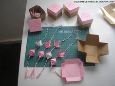 Origamis (a partir da esquerda): Astra , Hortênsia , Tsuru e Bola de Borboletas Origamis: Tsuru e Bola Ori...