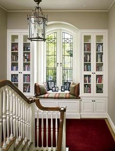 Bookcase and window seat on staircase landing