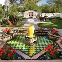 Arizona residence reflects haciendas of southern Spain. With a Moorish-inspired tiled fountain, the entry to this courtyard is emblematic of Spanish Hacienda-style design.