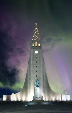 Aurora Borealis showing up in Iceland, making Hallgrimschurch looking really good. In front of it we have the statue of Ingolfur Arnarsson - the first settler to America. Learn more about Iceland here: http://www.northernlightsiceland.com/