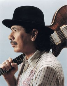 Carlos Augusto Alves Santana (born July 20, 1947) is a Mexican and American musician who first became famous in the late 1960s and early 1970s with his band, Santana, which pioneered a fusion of rock and Latin American music. The band's sound featured his melodic, blues-based guitar lines set against Latin and African rhythms featuring percussion instruments such as timbales and congas not generally heard in rock music.
