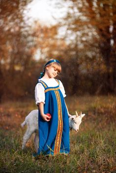 Little Russian girl in traditional peasant dress