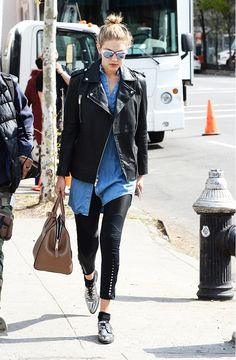 Gigi Hadid adds an edge to her look with a motorcycle jacket and silver oxfords