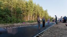 Salto Architects, an Estonia-based practice, has designed the ultimate moving sidewalk. Instead of creeping forward slowly on a large conveyor belt, pedestrians fling themselves ahead a few metres at a time on a giant, continuous trampoline. Called Fast Track, a 51-metre test strip was installed this summer in Nikola-Lenivets, Russia. (Salto Architects)