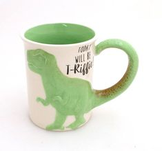 This sculpted t rex will help you feel less prehistoric in the morning! My original design created in stoneware clay. The front reads Today will be T-Riffic and the back reads: Let Them Hear You Roar. Measures 4 x 4 and holds 16 oz- safe to place in the dishwasher and microwave. Built to