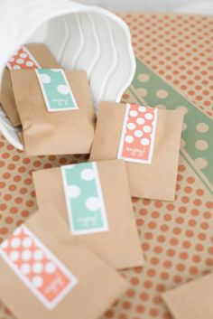 Michaels.com Wedding Department: Playful Dot Favors Customize your favor with polka-dot flavor. A simple kraft envelope is transformed into a fun and fanciful wedding treat favor. Printable label tags allow you to create your color of flavorful fun. Courtesy of Gartner Studios®