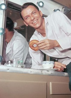 Frank Sinatra, having a cup of coffee & donut