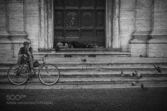 The cyclist and the sleepy homeless by ORLO