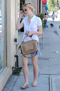 Elle Fanning out and about, Los Angeles wearing a polo shirt with jean shorts and nude flip-flops on Sept. 1, 2016.#ellefanning #streetstyle #flipflops #fashion #shortsoutfit Comfy Shoes, Comfortable Shoes, Nude Flip Flops, Elle Fanning, Celebrity Look, Christina Hendricks, Jennifer Aniston, Chanel Boy Bag, Flipping