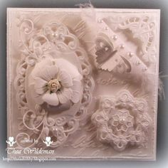 Anyone that uses dies in making their cards would definitely love the Marianne Design Card Gallery...tons of gorgeous cards there such as this one. I love this white on white look.
