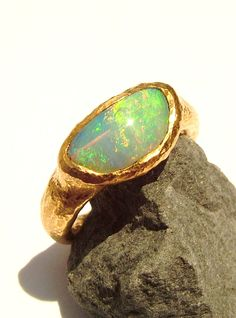 Australian Opal crystal ring.Love the hammered gold band .... might get opal in my wedding band