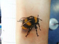 Wonderful Realistic Yellow And Black Bee Tattoo For Lady
