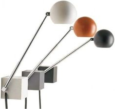 """$150  LYTEGEM LAMP  The classic Lytegem Lamp, designed in 1965 by Michael Lax. Weighted base allows for table top use. Hardware included for wall mounting. The arm telescopes from 6.5"""" to 15"""" and the lamp head swivels 360°. Hi-Lo-Off switch on base. UL-listed. 25W/12V bulb included"""