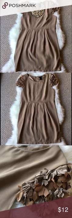 """ESLEY TAUPE MINI DRESS - Size: L This beautiful taupe mini dress is a show stopper. A size large. 33"""" inch long. No imperfections. Loops on the size for an accessory belt. Unique cloth feather ruffle short sleeves.80% Polyester, 20% cotton.  *** Price Firm *** ** Please ask all questions prior to purchasing!! ** Esley Dresses Mini"""