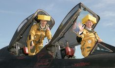 """Bob Meyer (left) and Ed Schneider humorously displayed """"cheesehead"""" hats after showing off one of Dryden's now-retired SR-71 Blackbird aircraft at the Experimental Aircraft Association's convention in Oshkosh, Wisconsin in 1997."""