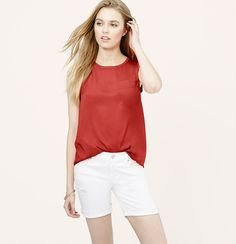 Made with a glossy woven front and a soft knit back, we love the mix-and-match ease of this summer staple. Scoop neck. Sleeveless. Chest pocket. Shirred back yoke. Banded neckline and armholes. Shirttail hem.