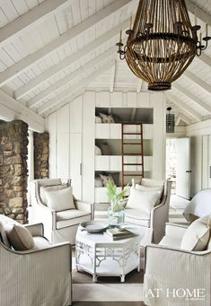Love the bunk wall. Lee Industries swivel chairs create a cozy sitting area.