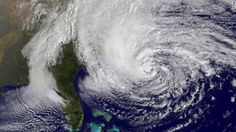 A satellite image from 10:10 a.m. ET on Sunday, October 28, shows Hurricane Sandy in the Atlantic Ocean grazing the East Coast. The storm is expected to cause massive flooding and widespread power outages when it hits the East Coast late Sunday and into the week.