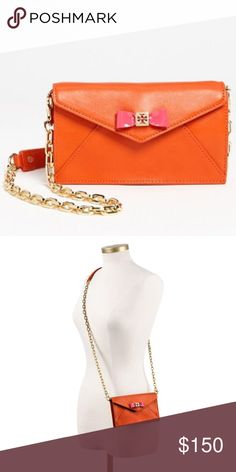 "Tory Burch envelope bow cross body purse Authentic Tory Burch envelope bow cross body purse in orange.  Super cute and in excellent used condition.  Strap is 22"" long. Tory Burch Bags Crossbody Bags"