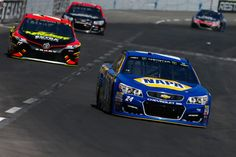 Chase Elliott Photos Photos - Chase Elliott, driver of the #24 NAPA Chevrolet, leads a pack of cars during the Monster Energy NASCAR Cup Series O'Reilly Auto Parts 500 at Texas Motor Speedway on April 9, 2017 in Fort Worth, Texas. - Monster Energy NASCAR Cup Series O'Reilly Auto Parts 500