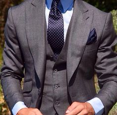 Grey suit / blue tie with white dots.
