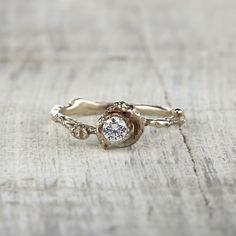 Rustic engagement ring, twig engagement ring, rustic wedding, outdoor wedding, nature inspired engagement ring, nature engagement ring, diamond engagement ring, unique engagement ring, alternative engagement ring by Olivia Ewing Jewelry | Bring a touch of nature to your proposal with this charming engagement ring. This romantic Petite Madrid Ring is decidedly perfect for any woman who has a love for all things nature or simply wants something more unique than all of her friends.