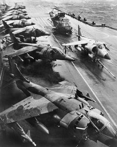 British Aerospace Harrier of No. 1 Squadron RAF and Royal Navy Sea Harrier on the flight deck of HMS HERMES during the deployment to the Falkland Islands, 19 May by Royal Navy official photographer at Imperial War Museum Prints Ww2 Aircraft, Aircraft Carrier, Military Jets, Military Aircraft, War Jet, British Aerospace, Falklands War, Flight Deck, Flight 19