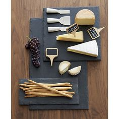 """Beautiful hand-shaped boards of natural slate show off unique flaked edge, providing an earthy foundation for cheeses, charcuterie or appetizers. Write directly on the slate cheese boards with chalk to label featured selections; simply wipe clean with a wet cloth. Felt backing protects tables.<br /><br />What you need to know to <a href=""""/ideas-and-advice/cheese-platter-ideas"""">make the perfect cheese platter</a>.<br /><br /><NEWTAG/><ul><li>Handcrafted</li><li>Natural charcoal slate with…"""