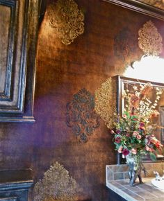 Glazed foil walls with raised Lusterstone stencils embedded with crushed glass.