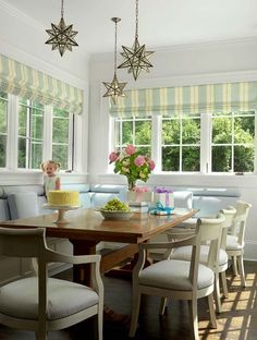 Feature Lighting: Add a touch of whimsy to your space like the adorable nook above. Moravian star light fixtures have been hung at varying heights for interest. To create mood lighting for the space, add a dimmer switch, perfect for the evening!  52 Incredibly fabulous breakfast nook design ideas