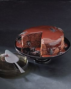 """Crunchy malt balls in the ganache center of this chocolate cake will leave you wondering if the """"cockroaches"""" are real. #Halloween"""