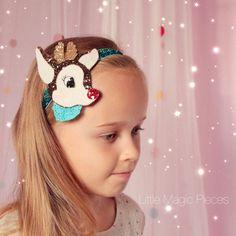 Christmas is coming! This Rudolph the Red Nosed Reindeer Glitter Headband is perfect for the festive Christmas season. Made with lots of love