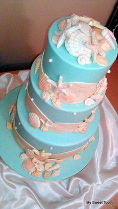Beach Theme Wedding Cake Teal with shades of taupe seashells