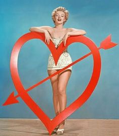 Here's a gallery of vintage Hollywood actress Valentine's Day pin-up photos, featuring Marilyn Monroe, Clara Bow, Angie Dickinson, Cyd Chari.