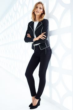 Black fitted jacket with contrasting white details, paired with slim-fit pants. | H&M Modern Classics