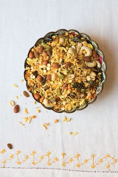 Hot Mix (Indian Spiced Snack Mix) | There are countless varieties of this ubiquitous Indian snack mix, made with varying combinations of nuts, fruit, spices, and other ingredients. Cookbook author Smita Chandra's version of the addictive nibble is the best we've had, with four kinds of nuts (cashew, peanut, almond, pistachio), plus sweet raisins, nutty coconut, and poha, dried flattened rice flakes.