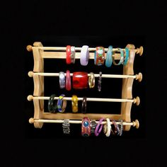 Hanging bracelet holder, mounted on a wall or other vertical surface. With walnut finish instead.