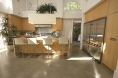 A polished concrete overlayment, will provide a seamless, flooring that will leave an amazing reflection.